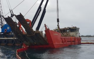 Barge being lifted out of the water